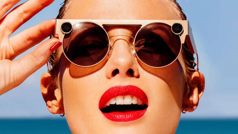 如何使用 Snap 眼镜拍照